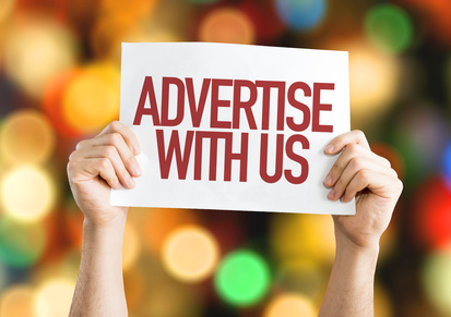 Advertise With Us placard with bokeh background